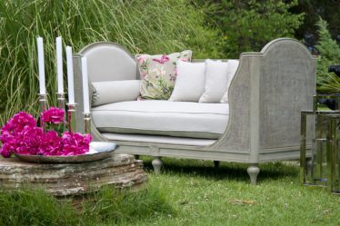 What to do on a staycation. Glamorous sofa seating in a garden.