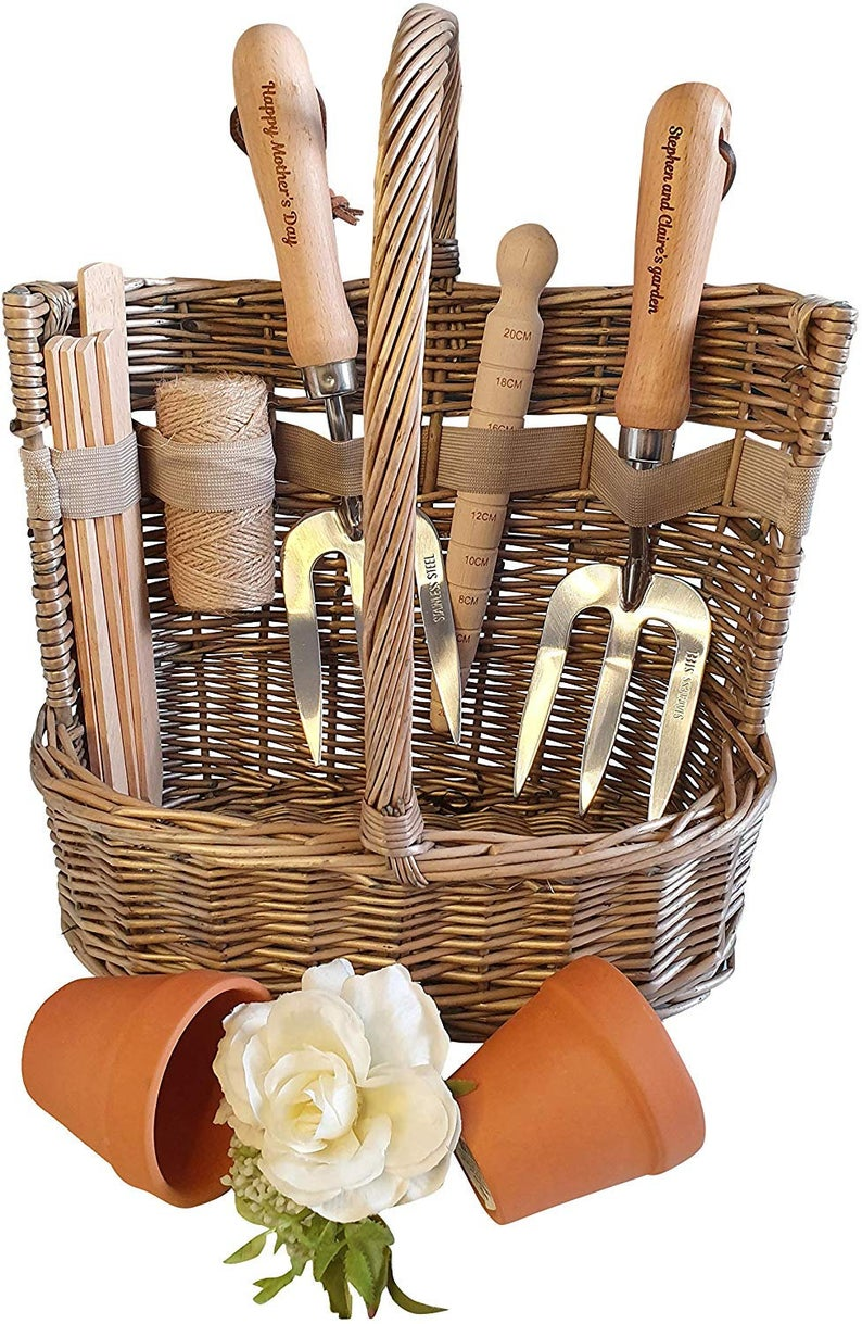 Gist set with garden trowel, plants labels in a wicker basket