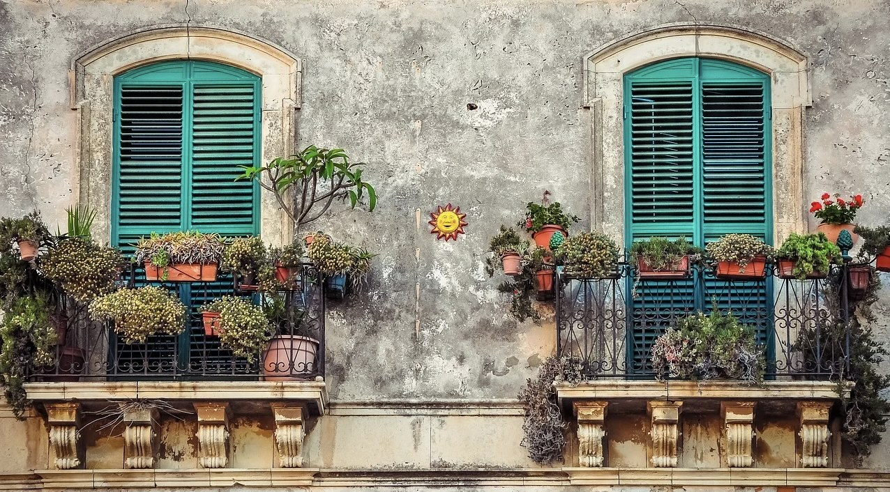 Balcony with pots of flowers
